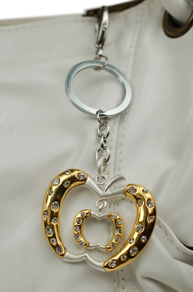 our apple and hearts costume jewellery chain worn as a bag charm